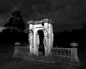 Cemetery Memorial Lit By Street Lamp