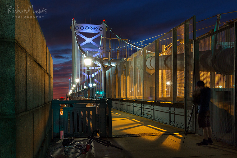 The Cycling Photographer on the Ben Franklin Bridge by Richard Lewis