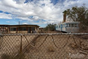 Abandoned House And Trailer With Rainbow In Bombay Beach
